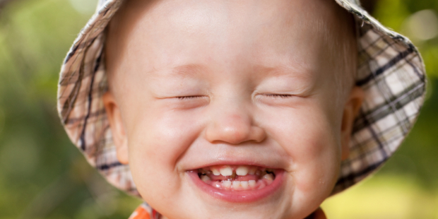 web2-kid-with-the-screwed-up-eyes-merry-laugh-shutterstock_110103698
