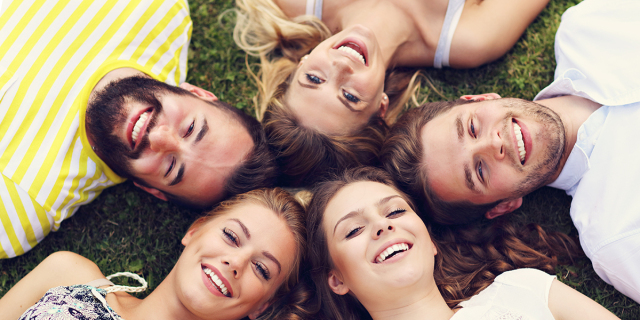 WEB3 - FRIENDS GROUP HAVING FUN TOGETHER ON GRASS -  shutterstock_686762221
