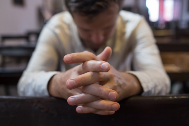 Caucasian,Man,Praying,In,Church.,He,Has,Problems,And,Ask